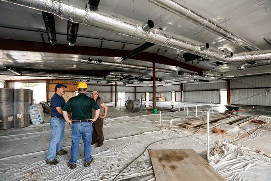 Renee Webb, shelter manager at Fond du Lac Humane Society (far right) talks with architect Tom Meiklejohn and humane society Board of Directors President Joe Leventhal on Sept. 14, 2018, as they stand in the new humane society facility under construction at Triangle Road in Fond du Lac, Wisconsin.