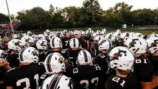 Fond du Lac football head coach Steve Jorgensen talks to his team before the start of their game against Hortonville last September at Fruth Field in Fond du Lac.