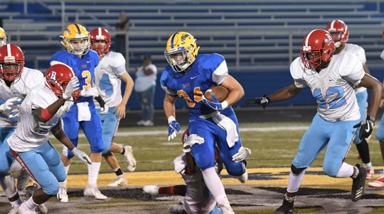 Clyde's Braydi Clark rushed for four scores against Bowsher.
