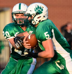 Margaretta's Nick Leibacher, left, threw three touchdown passes while Brycetyn Hedden, right, rushed for two against Danbury.