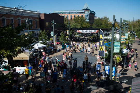 Crowds gather around Old Town Square while the Symbols perform on the Choice Organics stage during Fortoberfest 2018 on Saturday, Sept. 15, 2018, in Fort Collins, Colo.