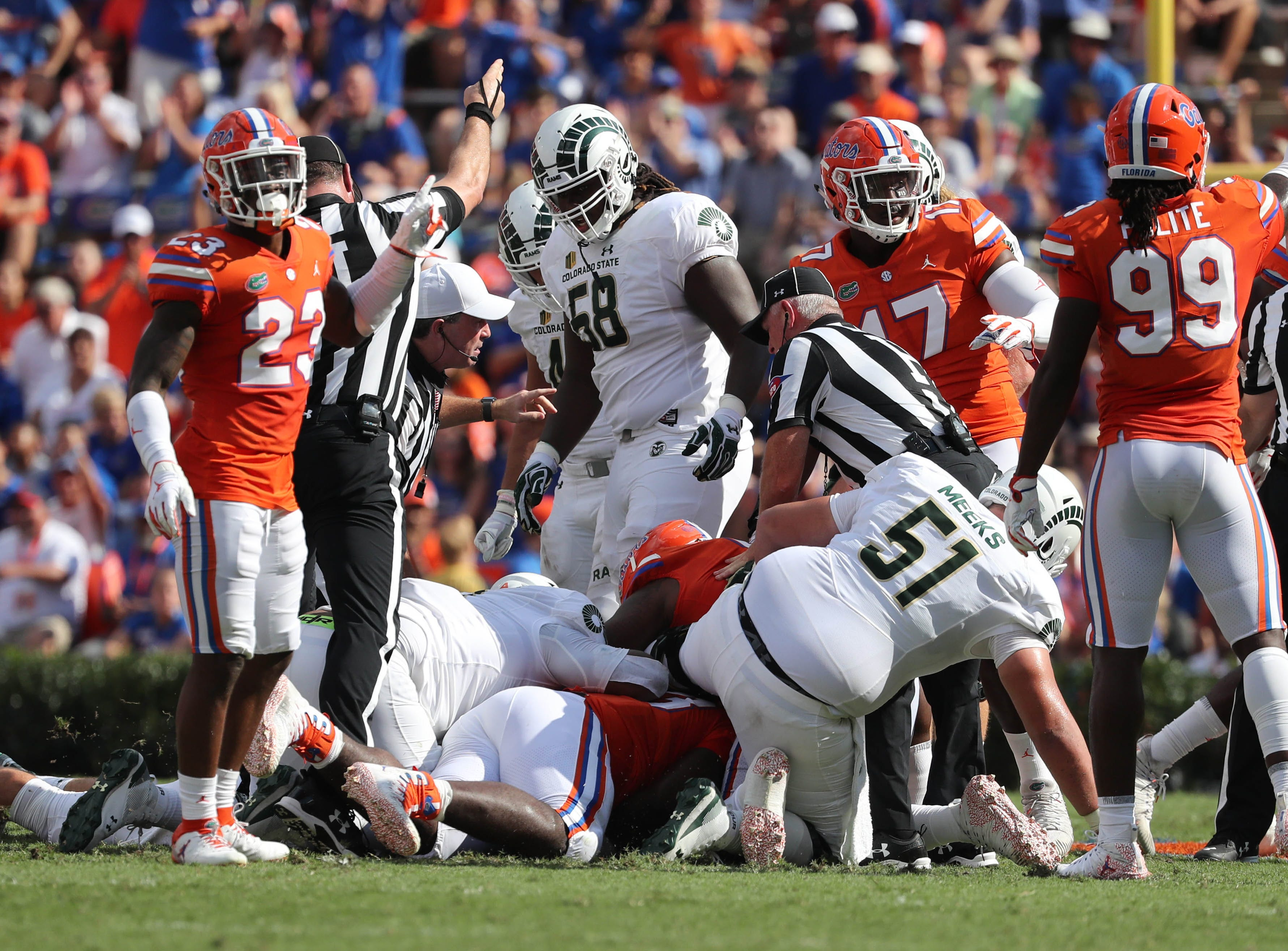 Sep 15, 2018; Gainesville, FL, USA; Florida Gators defensive end Elijah Conliffe (93) recover the fumble against the Colorado State Rams during the first quarter at Ben Hill Griffin Stadium. Mandatory Credit: Kim Klement-USA TODAY Sports