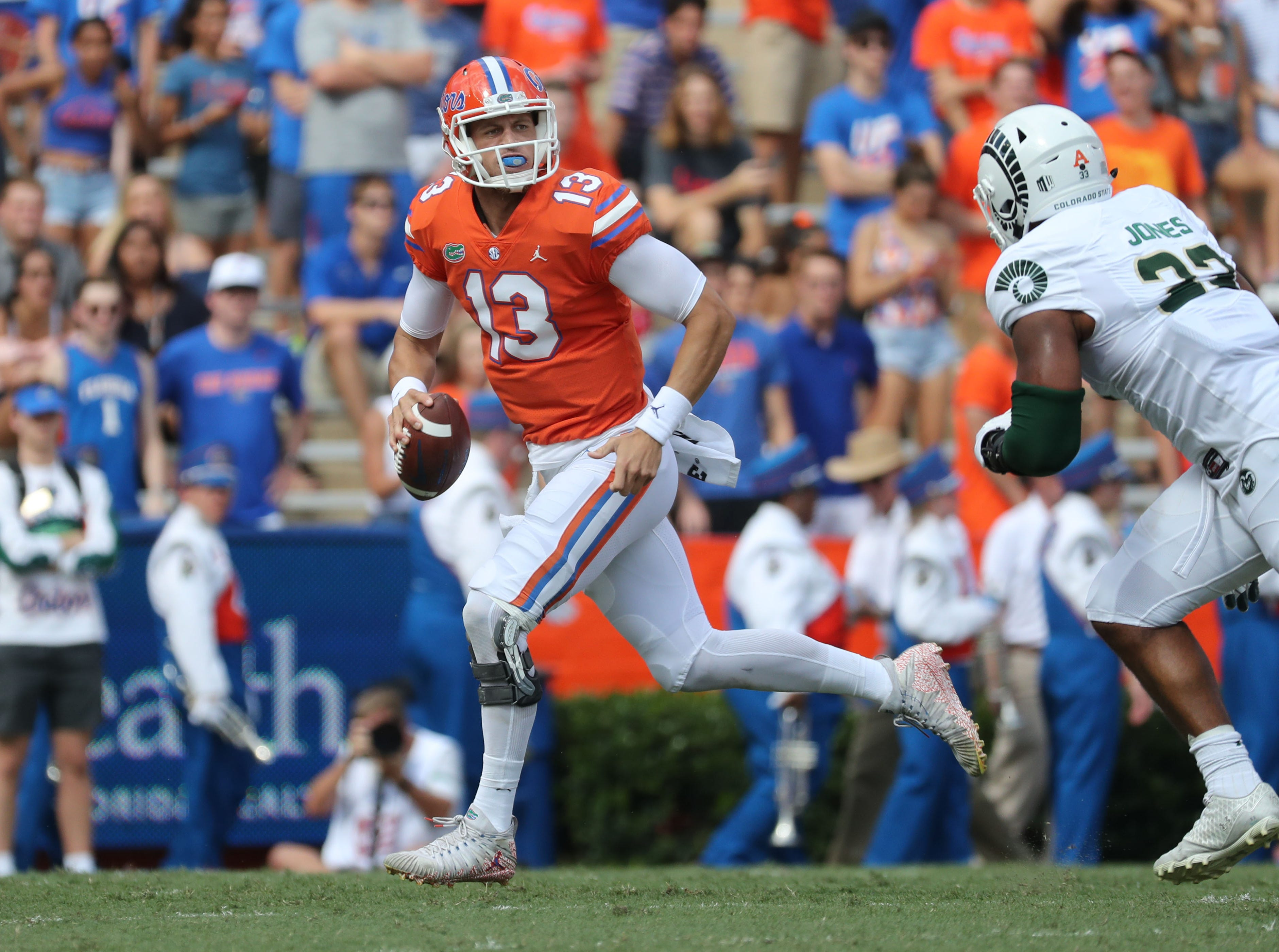Sep 15, 2018; Gainesville, FL, USA; Florida Gators quarterback Feleipe Franks (13) runs out of the pocket as Colorado State Rams defensive end Emmanuel Jones (33) rushes during the first quarter at Ben Hill Griffin Stadium. Mandatory Credit: Kim Klement-USA TODAY Sports