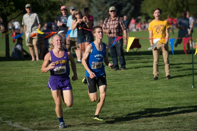 James Gregory of Fort Collins and John Houdeshell of Poudre race to the finish line during the John Martin Invitational cross country meet at Fort Collins High School on Friday, September 14, 2018.
