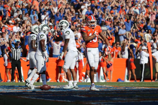Sep 15, 2018; Gainesville, FL, USA; Florida Gators wide receiver Freddie Swain (16) celebrates as he catches the ball for a touchdown against the Colorado State Rams during the second quarter at Ben Hill Griffin Stadium. Mandatory Credit: Kim Klement-USA TODAY Sports