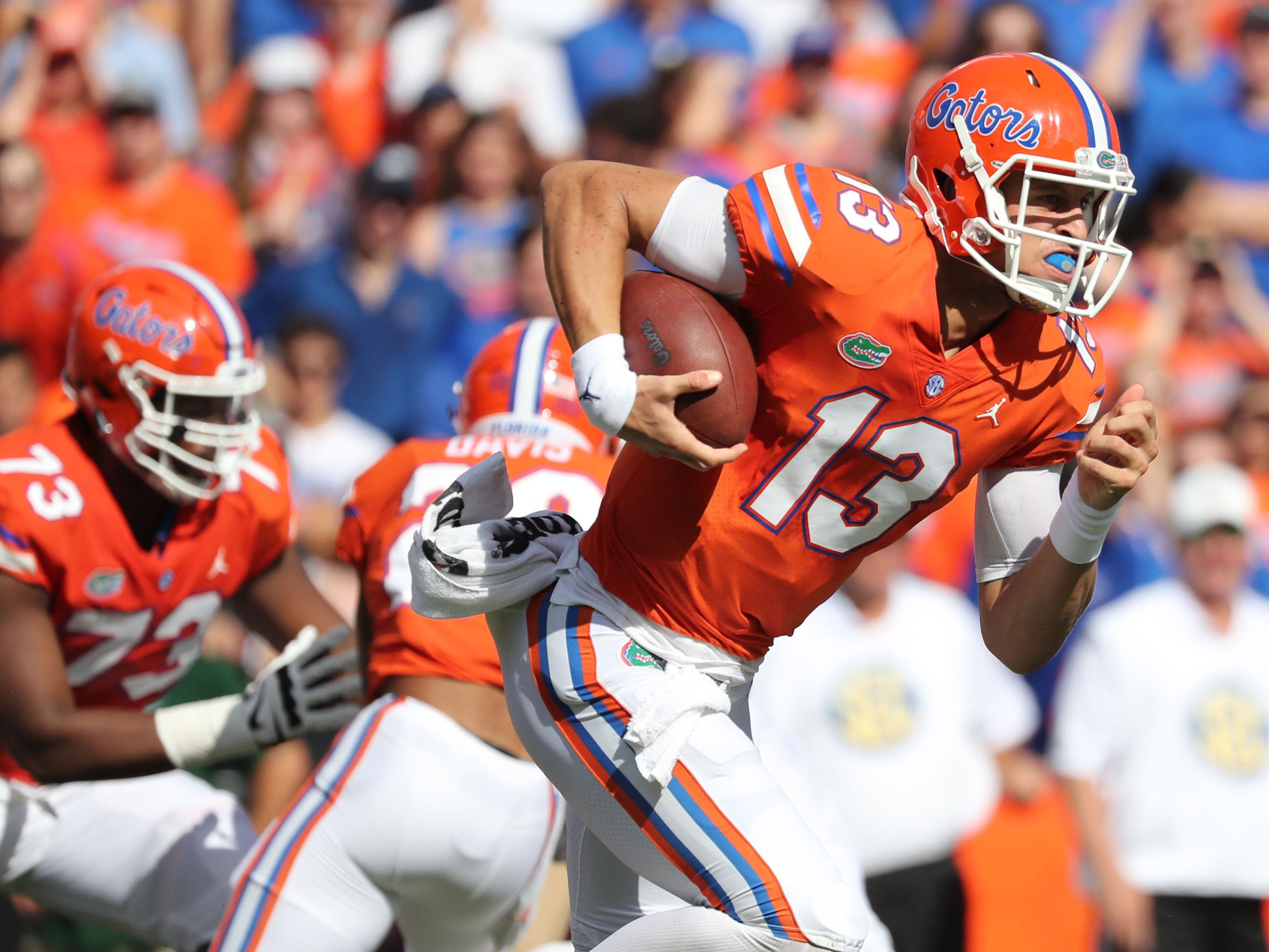Sep 15, 2018; Gainesville, FL, USA;Florida Gators quarterback Feleipe Franks (13) runs with the ball against the Colorado State Rams during the first quarter at Ben Hill Griffin Stadium. Mandatory Credit: Kim Klement-USA TODAY Sports