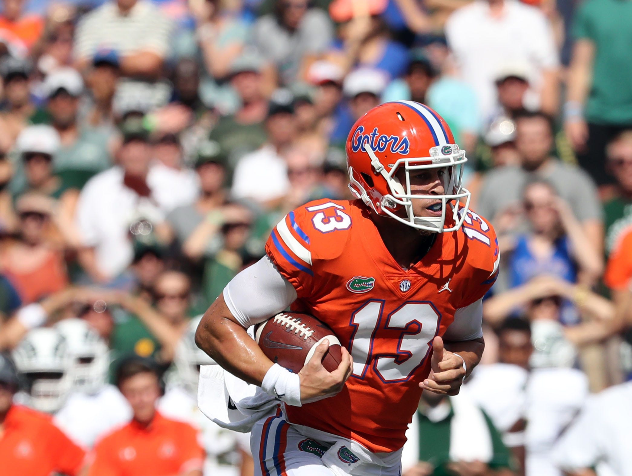Sep 15, 2018; Gainesville, FL, USA; Florida Gators quarterback Feleipe Franks (13) runs with the ball against the Colorado State Rams during the first quarter at Ben Hill Griffin Stadium. Mandatory Credit: Kim Klement-USA TODAY Sports