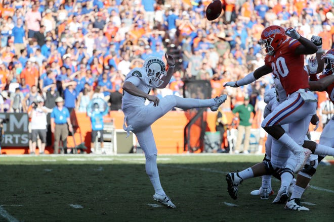 Florida safety Amari Burney (30) blocks a punt by CSU's Ryan Stonehouse that the Gators recovered in the end zone for a touchdown Saturday during a 48-10 win over the Rams at Ben Hill Griffin Stadium in Gainesville, Fla. The blocked punt was one of several special-teams errors by the Rams that led directly to 27 Florida points.