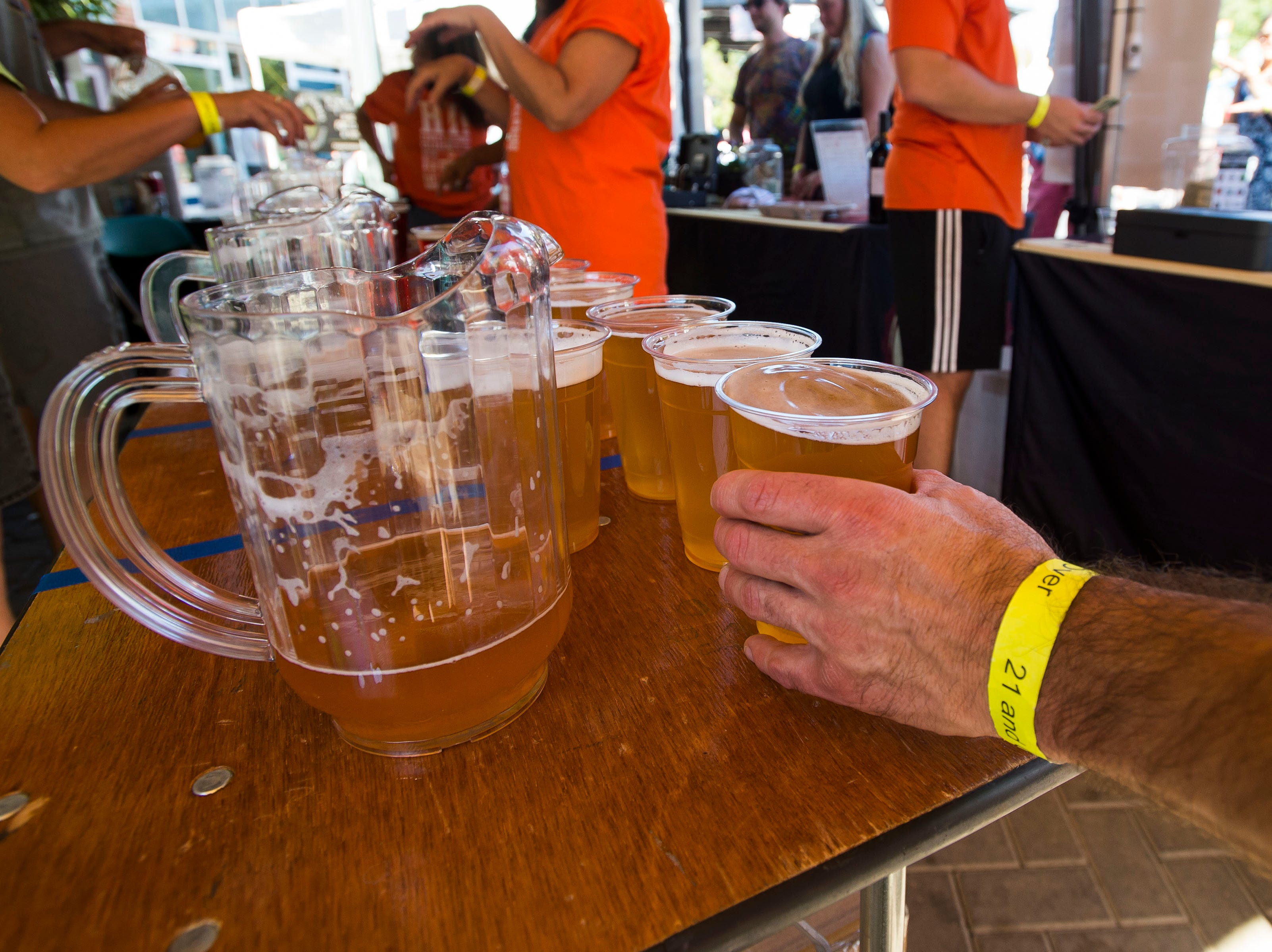 Volunteer Eric Giersch grabs a patron an Odell Brewing Easy Street wheat beer during Fortoberfest 2018 on Saturday, Sept. 15, 2018, at Old Town Square in Fort Collins, Colo.