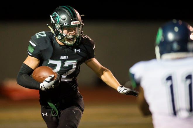 Fossil Ridge High School senior running back Casey Knutsen (32) looks to cut upfield during a homecoming game against Overland High School on Friday, Sept. 14, 2018, at French Field in Fort Collins, Colo.