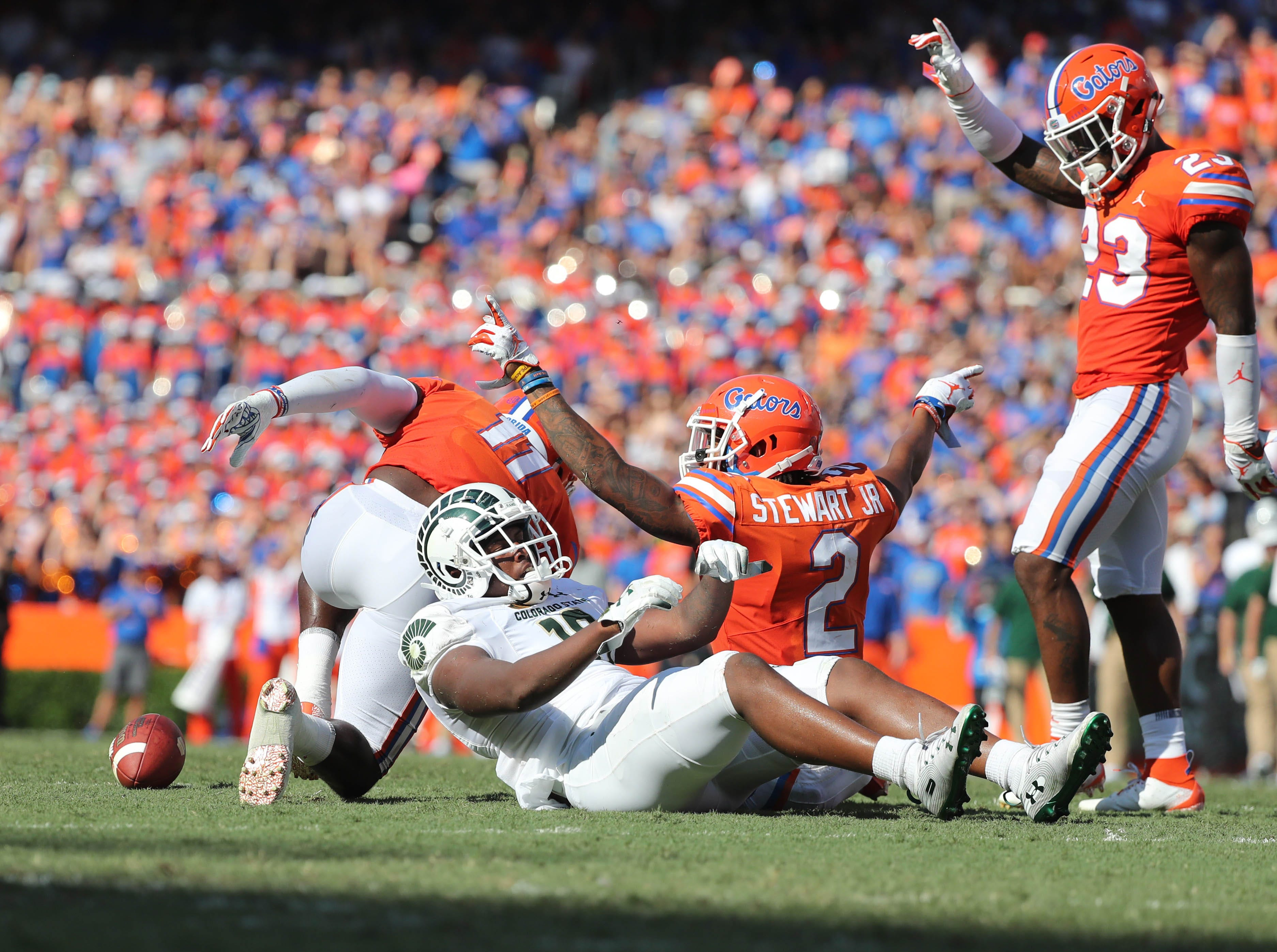 Sep 15, 2018; Gainesville, FL, USA; Florida Gators linebacker Vosean Joseph (11) , defensive back Brad Stewart Jr. (2) and Fdefensive back Chauncey Gardner-Johnson (23) break up a pass to Colorado State Rams tight end Cameron Butler (16) during the first quarter at Ben Hill Griffin Stadium. Mandatory Credit: Kim Klement-USA TODAY Sports