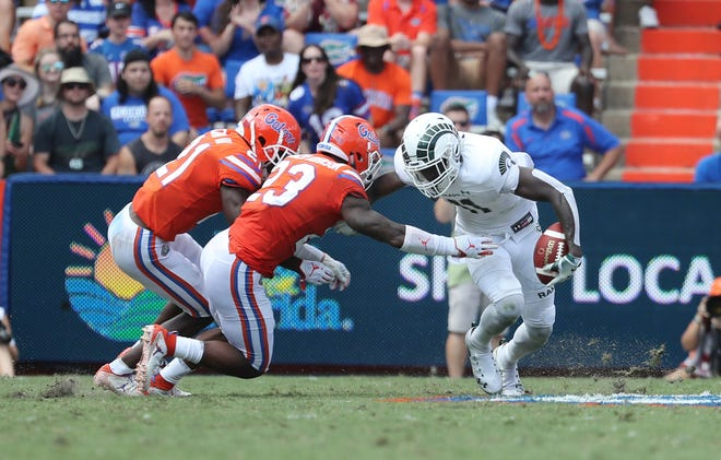 Sep 15, 2018; Gainesville, FL, USA; Colorado State Rams wide receiver Preston Williams (11) runs with the ball as Florida Gators defensive back Chauncey Gardner-Johnson (23) tackles during the second quarter at Ben Hill Griffin Stadium. Mandatory Credit: Kim Klement-USA TODAY Sports