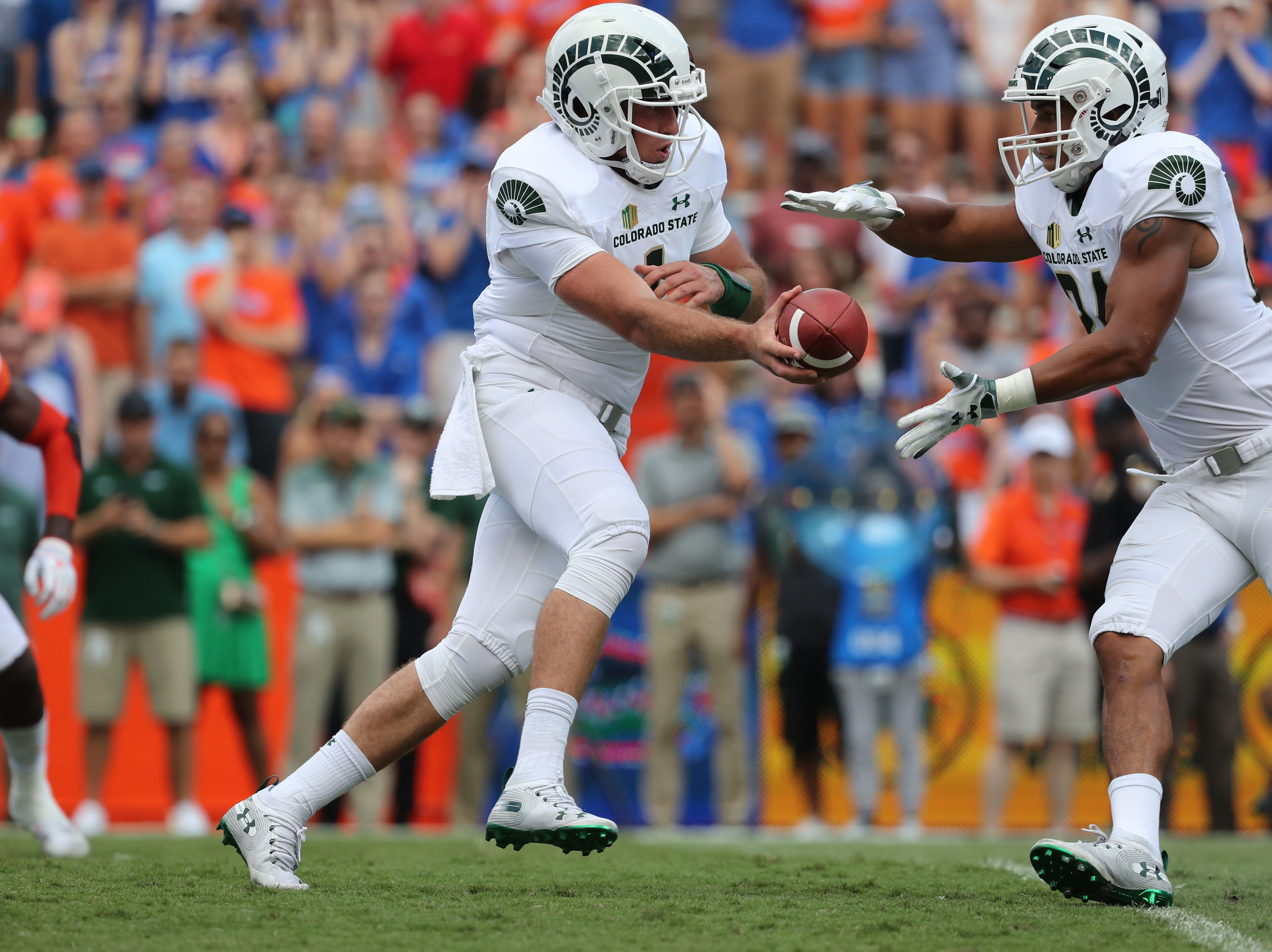Sep 15, 2018; Gainesville, FL, USA; Colorado State Rams quarterback K.J. Carta-Samuels (1) hands the ball off to Colorado State Rams running back Izzy Matthews (24) against the Florida Gators during the first quarter at Ben Hill Griffin Stadium. Mandatory Credit: Kim Klement-USA TODAY Sports