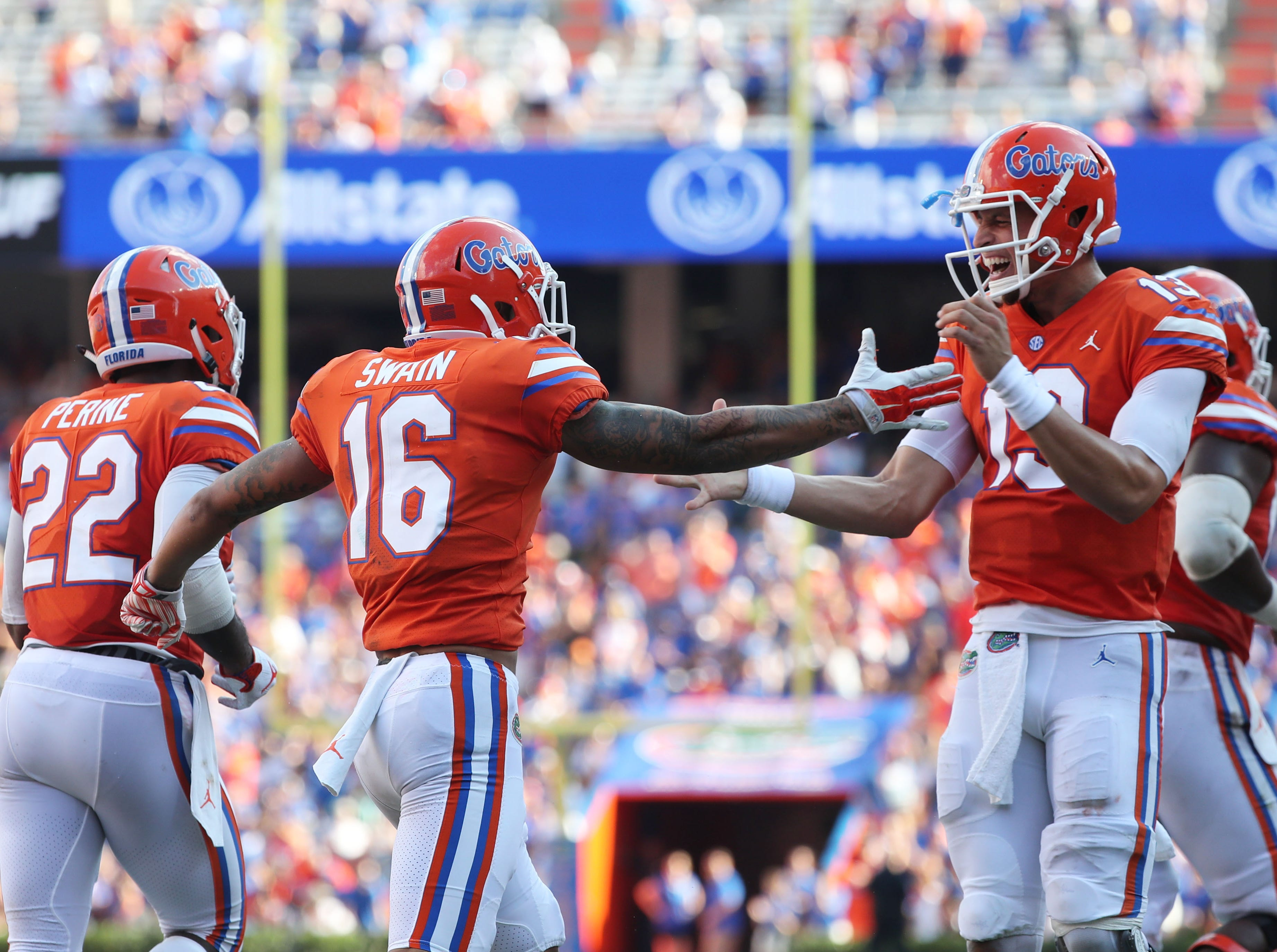 Sep 15, 2018; Gainesville, FL, USA; Florida Gators wide receiver Freddie Swain (16) is congratulated by Florida Gators quarterback Feleipe Franks (13) as he catches the ball for a touchdown against the Colorado State Rams during the second quarter at Ben Hill Griffin Stadium. Mandatory Credit: Kim Klement-USA TODAY Sports