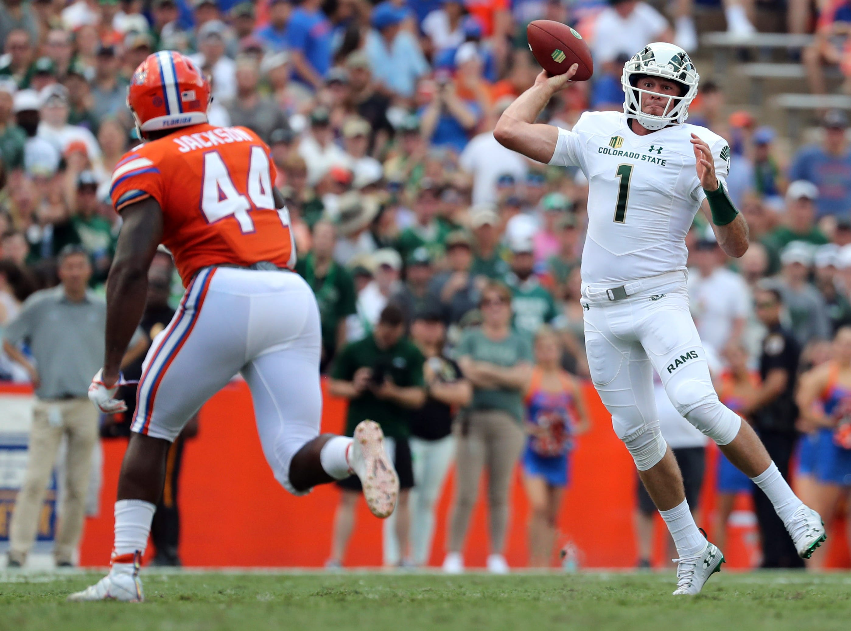 Sep 15, 2018; Gainesville, FL, USA; Colorado State Rams quarterback K.J. Carta-Samuels (1) throws the ball as Florida Gators linebacker Rayshad Jackson (44) defends during the first quarter at Ben Hill Griffin Stadium. Mandatory Credit: Kim Klement-USA TODAY Sports