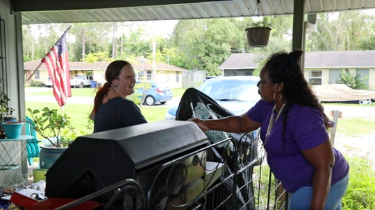 Frances Palmer, right, introduces herself to the renter in the other side of a North Fort Myers duplex she's looking at with her niece, Ebony Lee of Fort Myers. Lee, who lives at embattled Jones Walker apartments, hopes she and other residents will be given Section 8 vouchers so they can move to better housing. But, she and Palmer agree, the duplex isn't better. Among the challenges of a possible move for Lee and other Jones Walker residents is leaving a diverse, more urban environment where they have family and friends for the more distant ex-burbs.