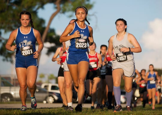 Barron Collier High School's Aaliyah Seaborn, center, competes Saturday in the Mariner Triton Invitational in Cape Coral. High schools from throughout Southwest Florida took part in the annual meet.