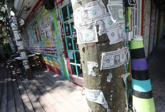 Saturday, some of the famous dollar bills that line the Captiva Café's walls were pulled off for island workers in need. And throughout the weekend, residents responded to a social media campaign: Help Bring the Green Back to Sanibel & Captiva by spending their money at local establishments.