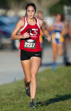 Evangelical Christian School's Elizabeth Wetmore competes Saturday in the Mariner Triton Invitational in Cape Coral. High schools from throughout Southwest Florida took part in the annual meet.