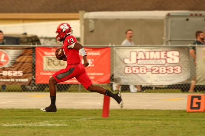 Red Knights quarterback Jesse Charles breaks numerous tackles along the Gators sideline and then coasts into the end zone to give North Fort Myers a 6–0 lead.