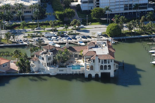 This BCB Home was built by Venetian Village off Gulfshore Drive North Drive.