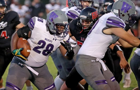 Green Bay West senior Kislam Robinson (28) runs the ball against Green Bay East in Bay Conference football at East High School Friday.