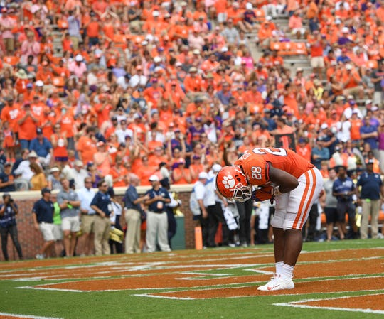 Clemson running back Tavien Feaster (28) bows after scoring against Georgia Southern during the 2nd quarter Saturday, September 15, 2018, at Clemson's Memorial Stadium.