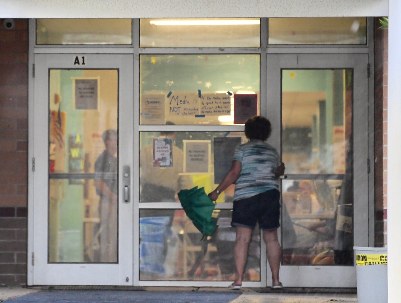 A woman walks into a shelter at Codington Elementary School in Wilmington N.C. on Saturday, Sept. 15, 2018.