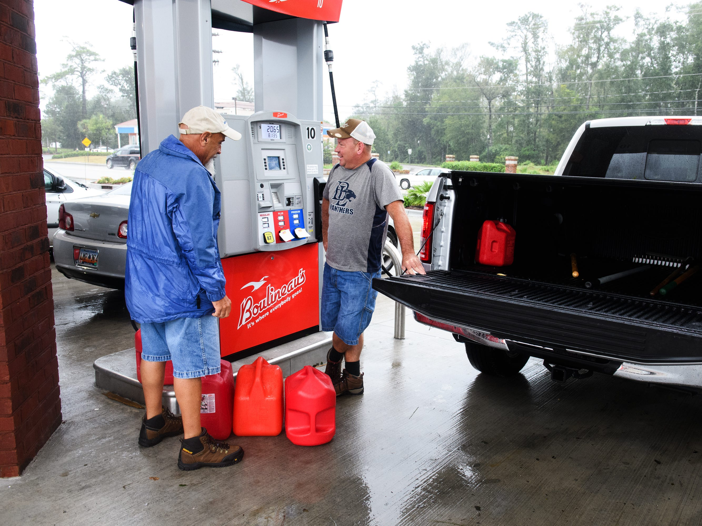 Keith Hanson and Les Goldstein fill their gas cans at Boulineau's Corner on Saturday, Sept. 15, 2018.