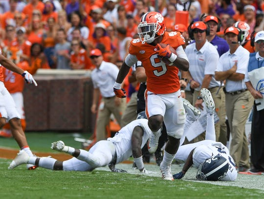 Clemson running back Travis Etienne (9) carries against Georgia Southern during the 2nd quarter Saturday at Clemson's Memorial Stadium.