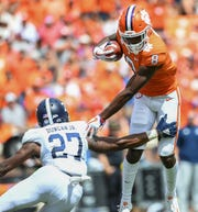 Clemson wide receiver Justyn Ross (8) eludes Georgia Southern safety Kenderick Duncan Jr. (27) on his way to scoring during the 2nd quarter Saturday, September 15, 2018, at Clemson's Memorial Stadium.