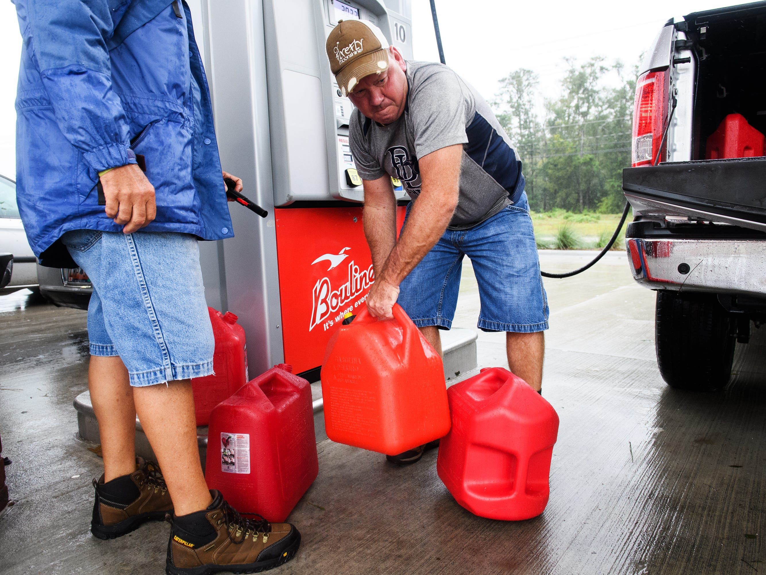 Keith Hanson loads one of his gas cans into his truck at Boulineau's Corner in North Myrtle Beach on Saturday, Sept. 15, 2018.