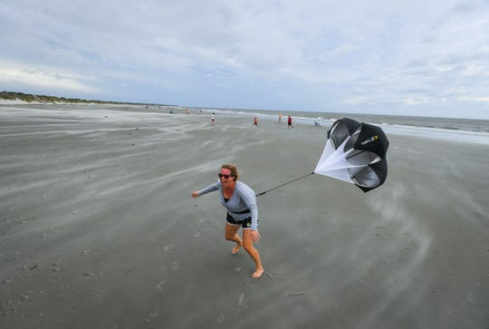 9/14/18 3:43:41 PM -- Isle of Palms, SC, U.S.A  -- Stephanie Lemke of Mt. Pleasant, SC, enjoys the increase in the winds on Isle of Palms Beach on Friday afternoon prior to the arrival of winds and rain from Hurricane Florence.  --    Photo by Jack Gruber, USA TODAY staff