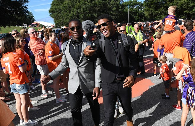 Clemson wide receiver Cornell Powell (17), left, and quarterback Kelly Bryant (2) take part in Tiger Walk before the Georgia Southern game Saturday, September 15, 2018, at Clemson's Memorial Stadium.