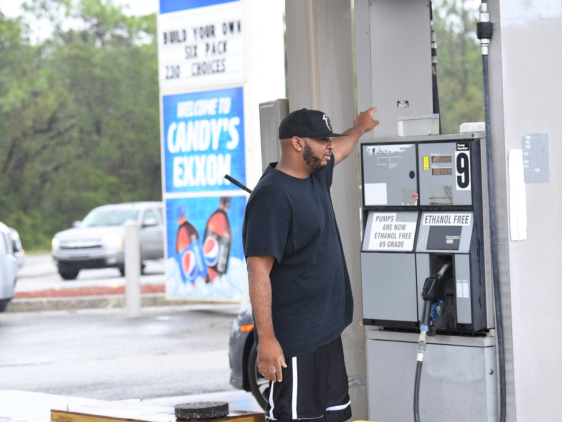 Robert Thomas gets gas from Candy's Exxon one of the few stations open in Wilmington on Saturday, Sept. 15, 2018.