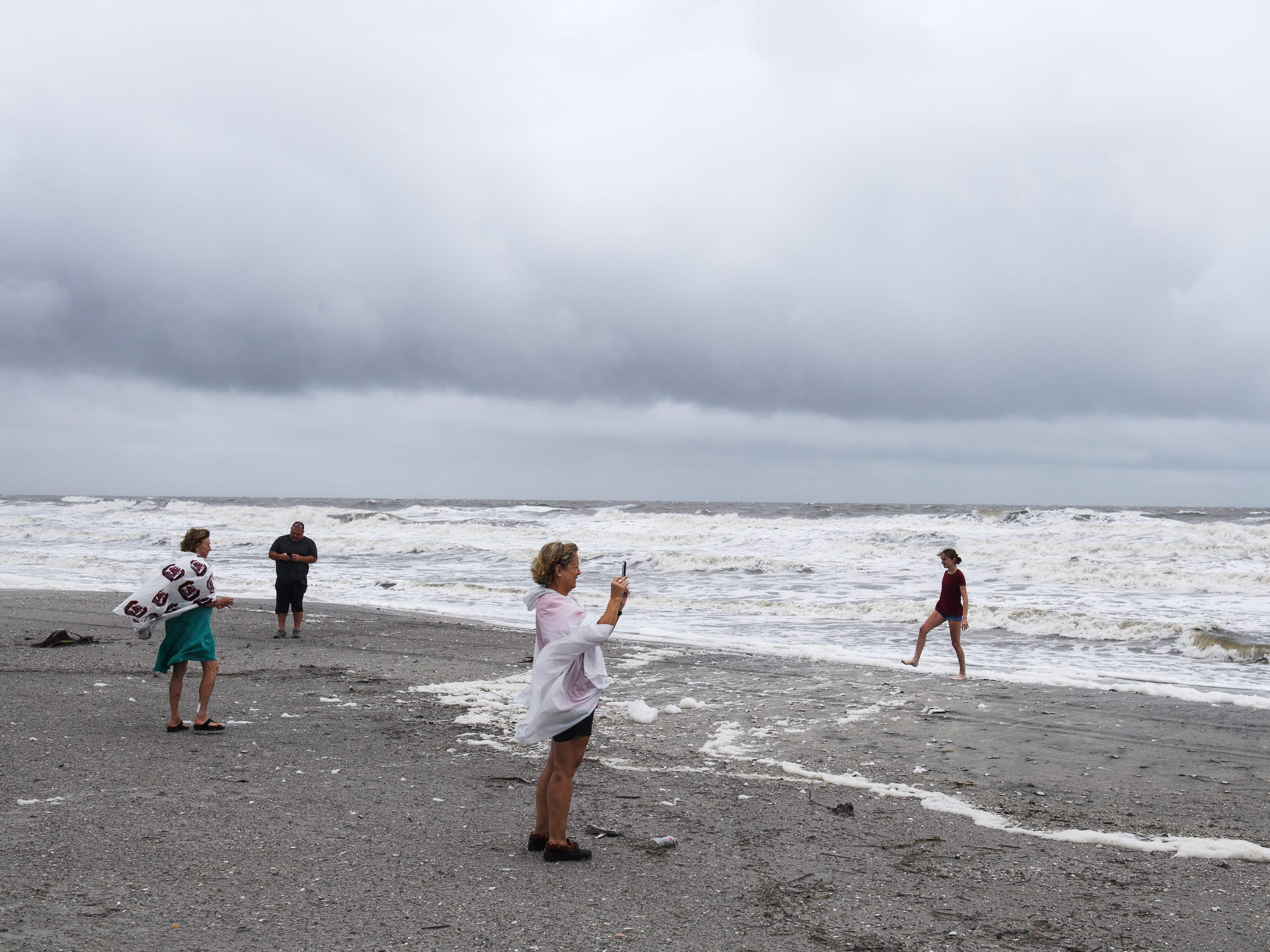 North Myrtle Beach residents check out the beach as high tide begins to come in on Saturday, Sept. 15, 2018.