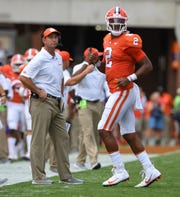 Clemson head coach Dabo Swinney and quarterback Kelly Bryant (2) watch the reply of Bryant's interception to Georgia Southern during the 1st quarter Saturday, September 15, 2018, at Clemson's Memorial Stadium.