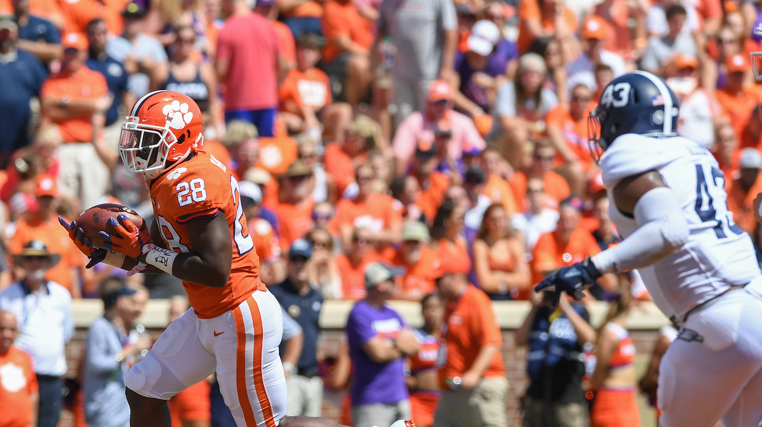 Clemson's Tavien Feaster leaves game early with injury, but returns with a bang