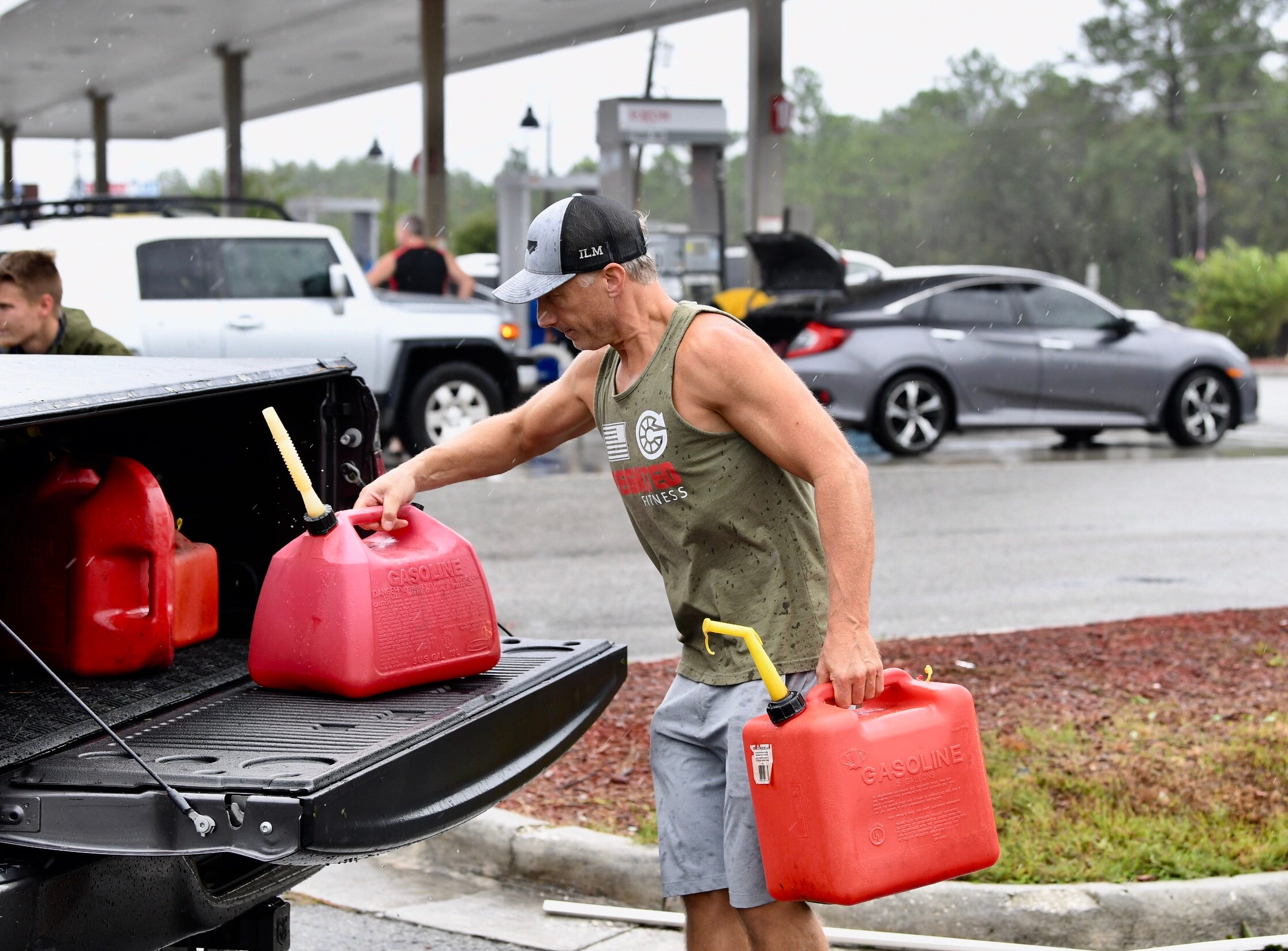 Blair Young loads up his gas at Candy's Exxon in Wilmington on Saturday, Sept. 15, 2018.