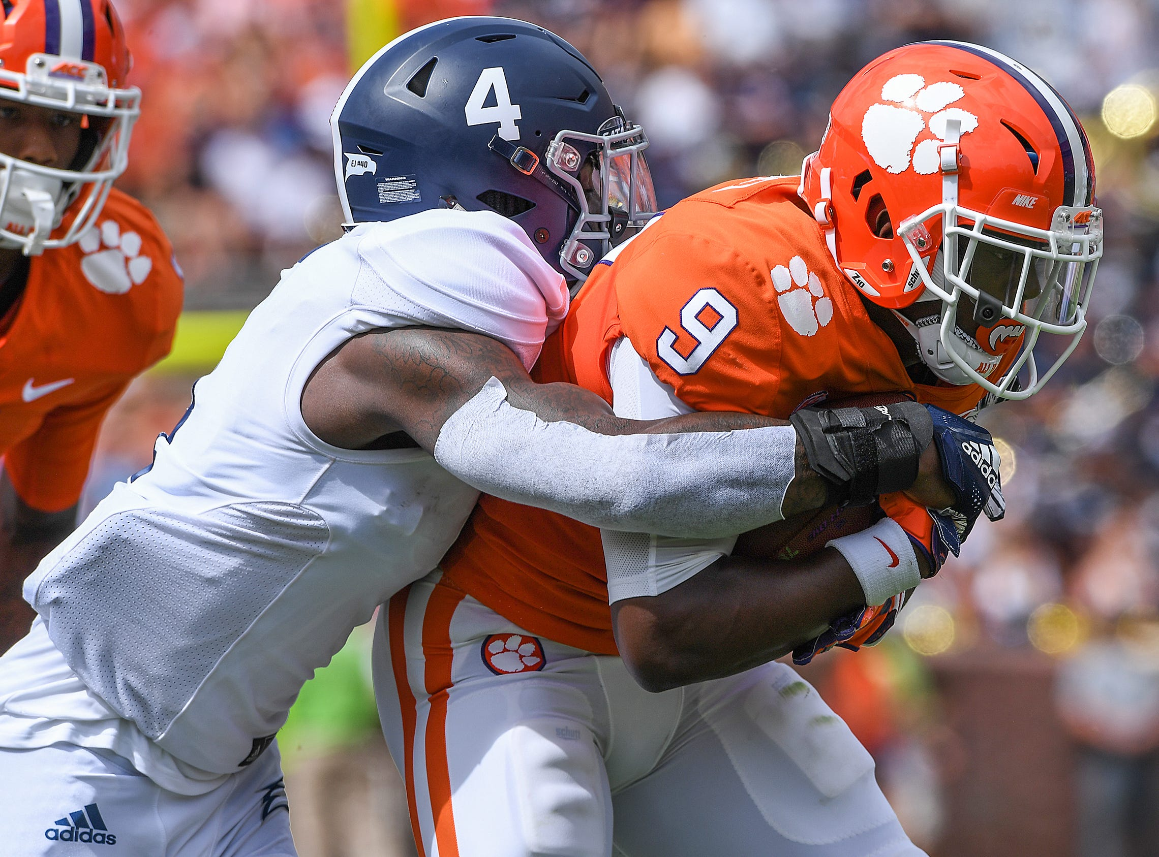 Georgia Southern cornerback Monquavion Brinson (4) wraps up Clemson running back Travis Etienne (9) during the 1st quarter Saturday, September 15, 2018, at Clemson's Memorial Stadium.