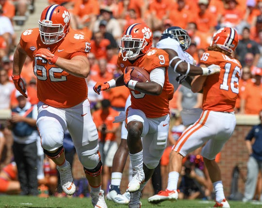 Clemson offensive lineman Cade Stewart (62) looks to block for running back Travis Etienne (9) as he carries against Georgia Southern during the 2nd quarter Saturday, September 15, 2018, at Clemson's Memorial Stadium.