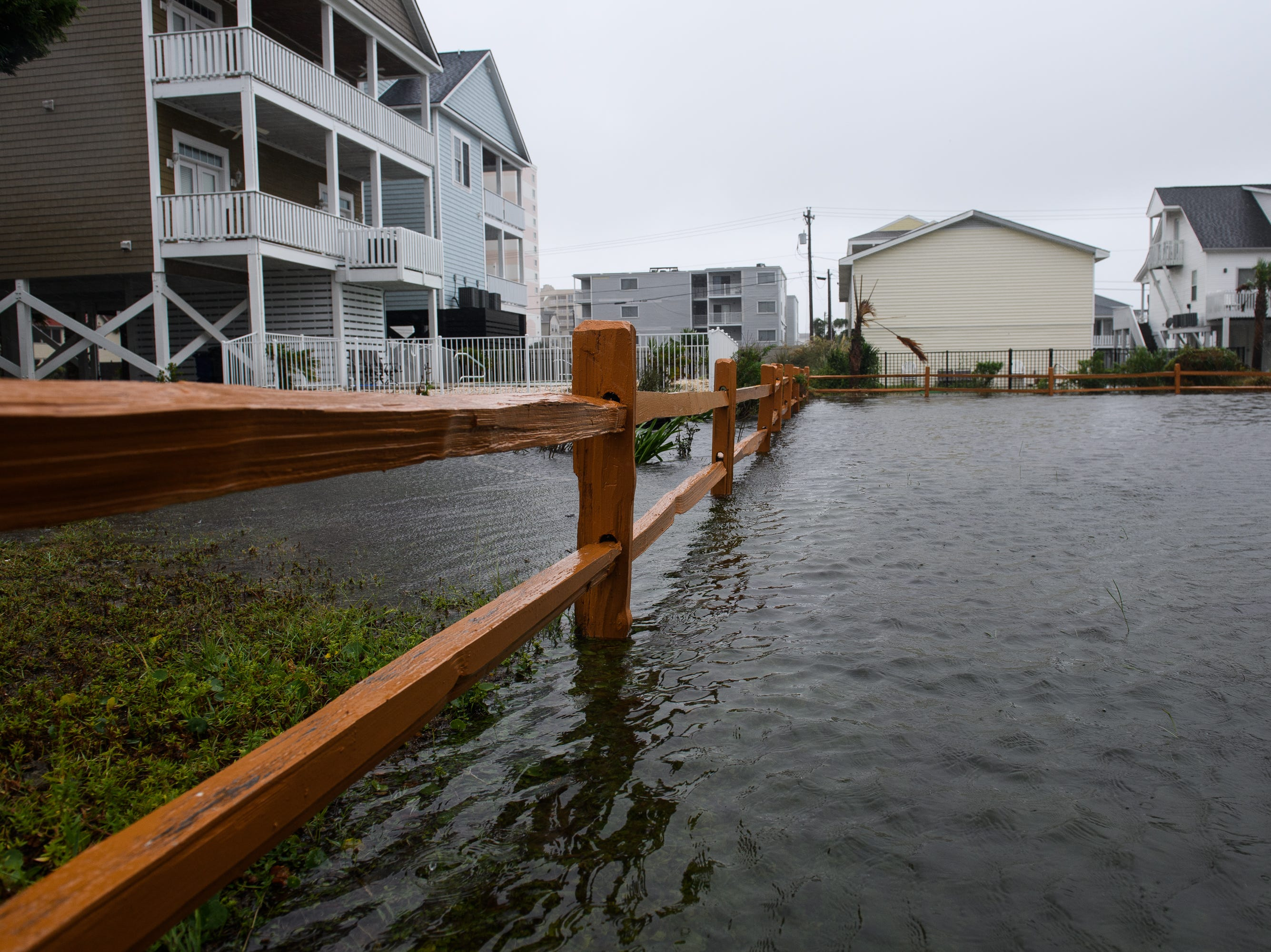 The yard of a home is flooded in the Cherry Grove neighborhood in North Myrtle Beach on Saturday, Sept. 15, 2018.