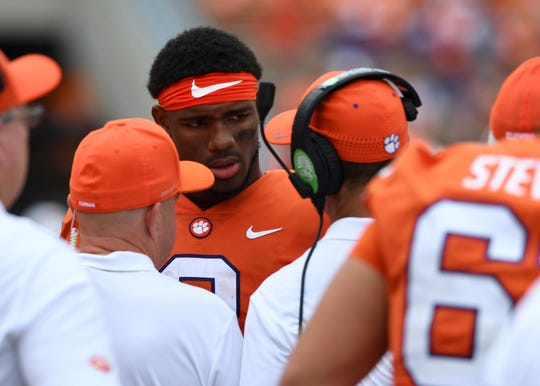 Clemson quarterback Kelly Bryant talks with head coach Dabo Swinney on the sideline during Clemson's game against Georgia Southern on Saturday, Sept. 15, 2018.