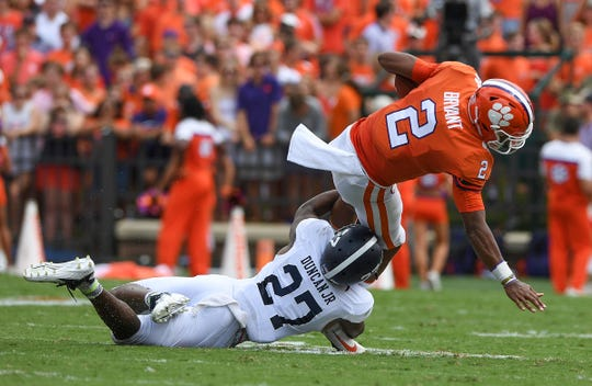 Georgia Southern safety Kenderick Duncan Jr. (27) takes down Clemson quarterback Kelly Bryant (2) during the 2nd quarter Saturday, September 15, 2018, at Clemson's Memorial Stadium. Bryant left the game briefly after the play.