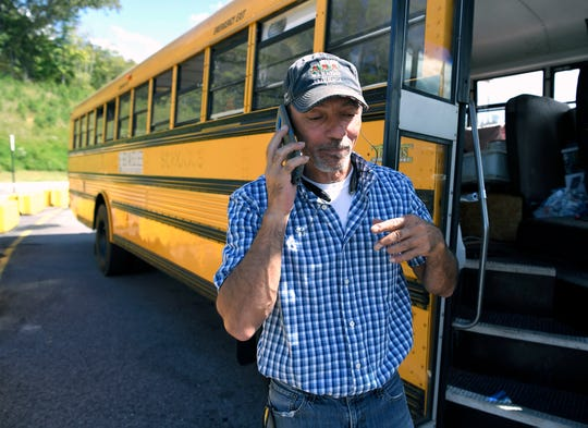 "Tony Alsup, 51, a Tennessee trucker, prepares to return to South Carolina to rescue pets from Tropical Storm Florence with his school bus. Alsup transported 64 dogs and cats to Alabama on Monday. And yes, his ringtone is ""Who Let the Dogs Out?"""