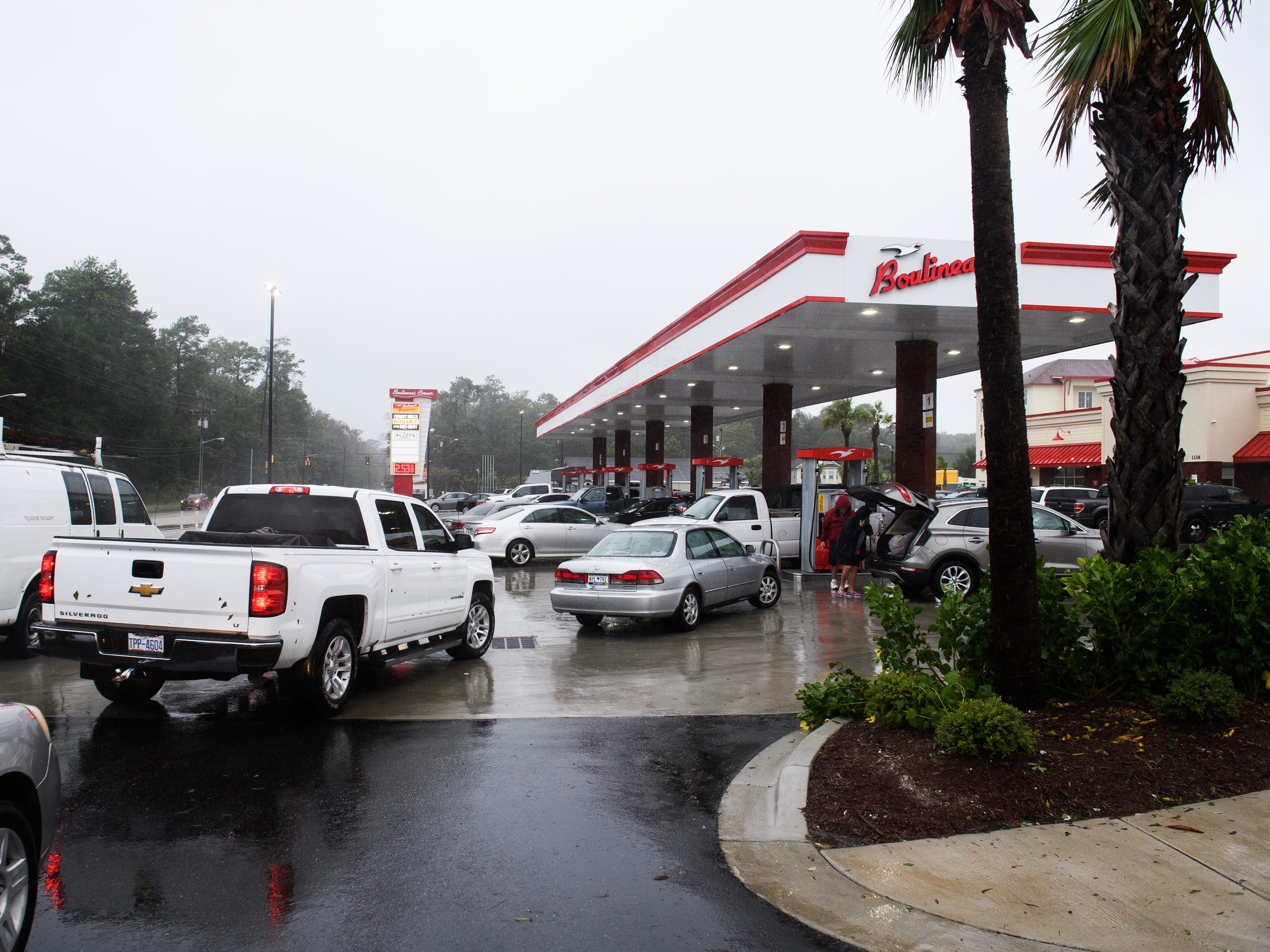 North Myrtle Beach residents swarm Boulineau's Corner, one of the first gas stations to open since Hurricane Florence swept through the area, on Saturday, Sept. 15, 2018.