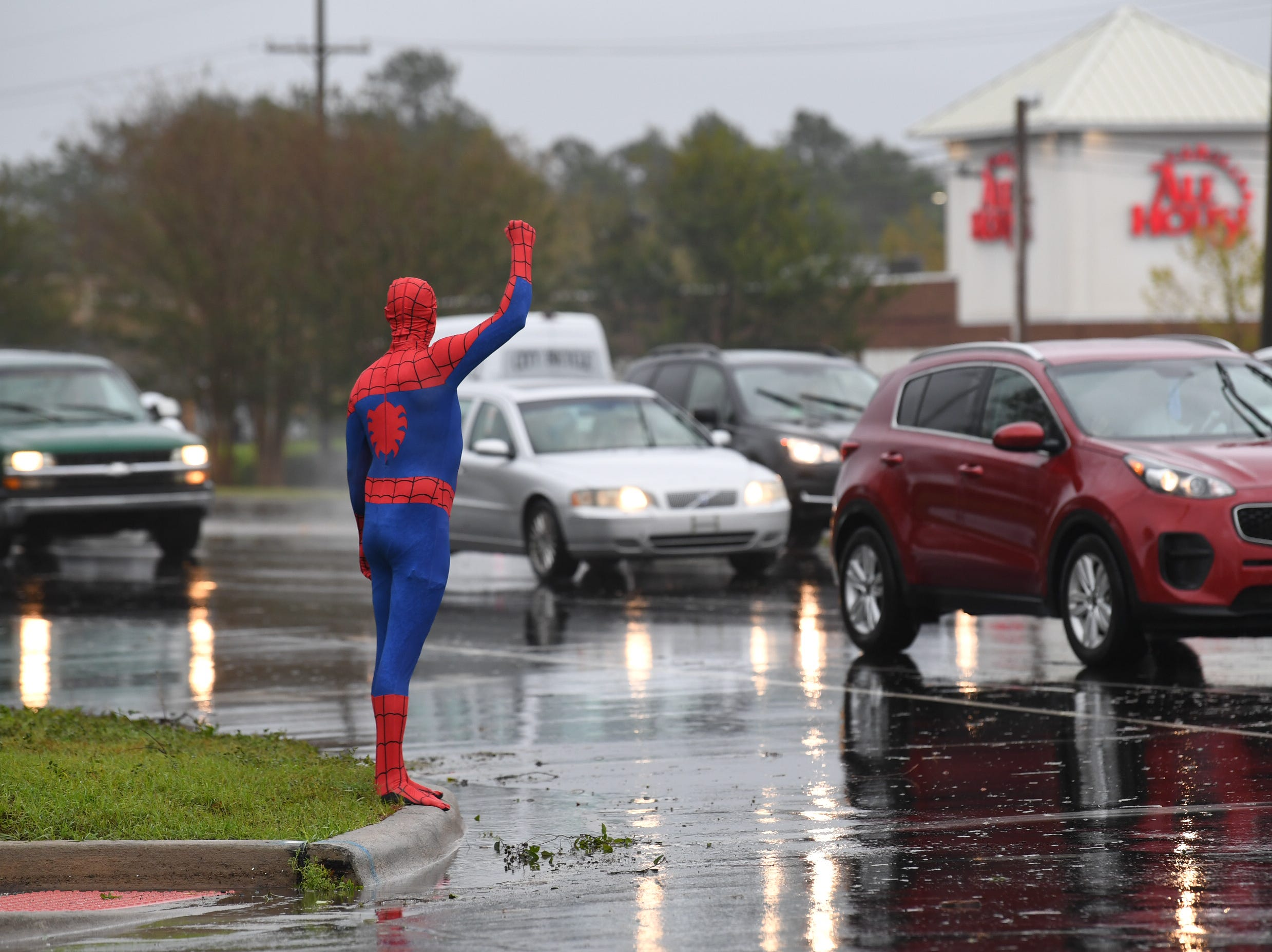 Rodney Foley of Wilmington in Spider-Man suit trying to cheer people up in Wilmington on Saturday, Sept. 15, 2018.