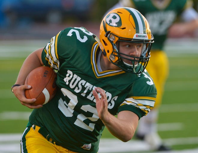 CMR's Jayson Ingalls carries the football in Friday's game against Billings Senior at Memorial Stadium.