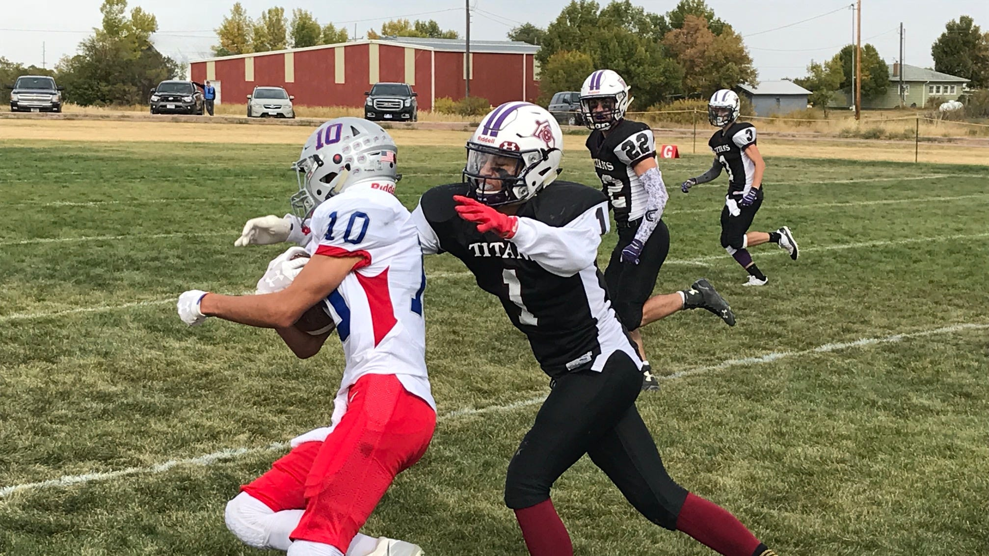 Denton-Geyser-Stanford's Zack Solomon (10) gets wrapped up by Brady Smelser of Power-Dutton-Brady during Six-Man football action in Dutton Saturday.