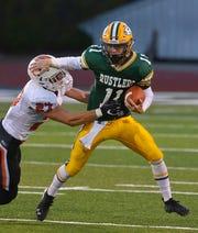 CMR quarterback Bryce Nelson attempts to avoid Billings Senior tackler Gunner Hegg during a football game at Memorial Stadium last season.